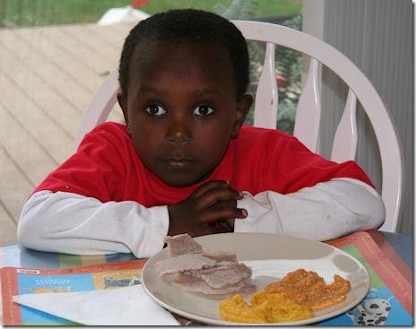 Feromsa eating injera