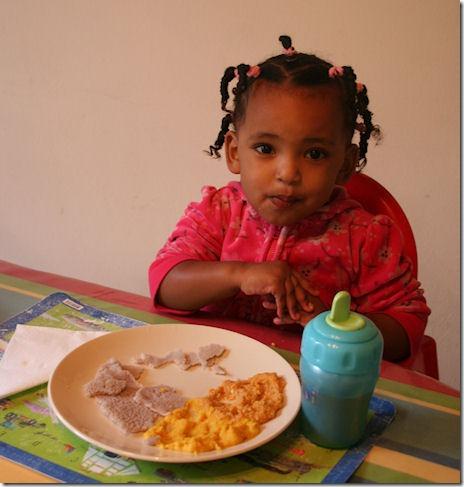 Feven eating injera